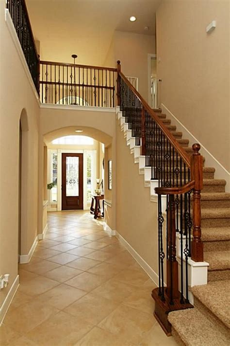 Dramatic staircase w/wrought iron detail